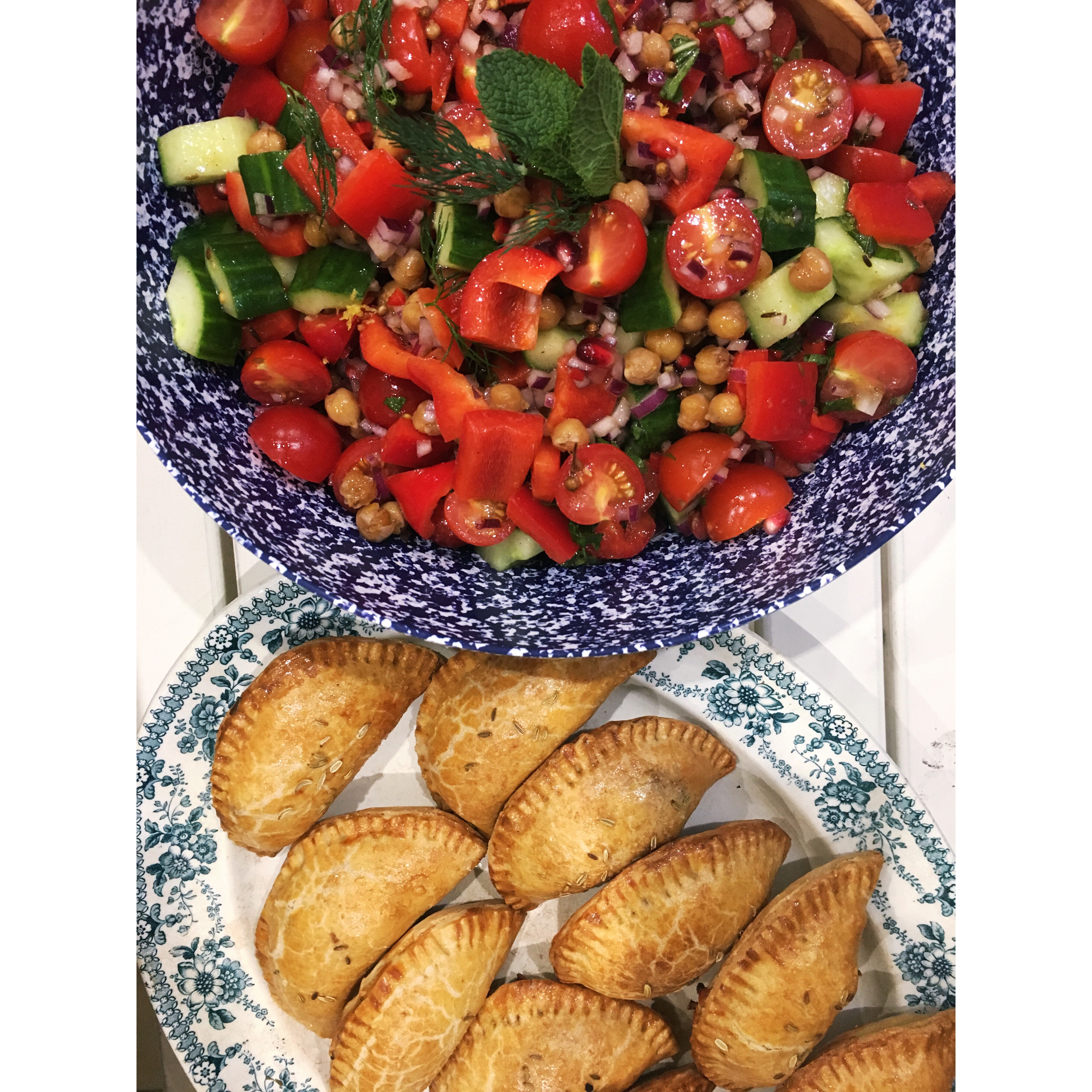 sweet potato, kale & manchego empanadas, chopped salad, spiced crispy chickpeas, mint, tomato, cucumber